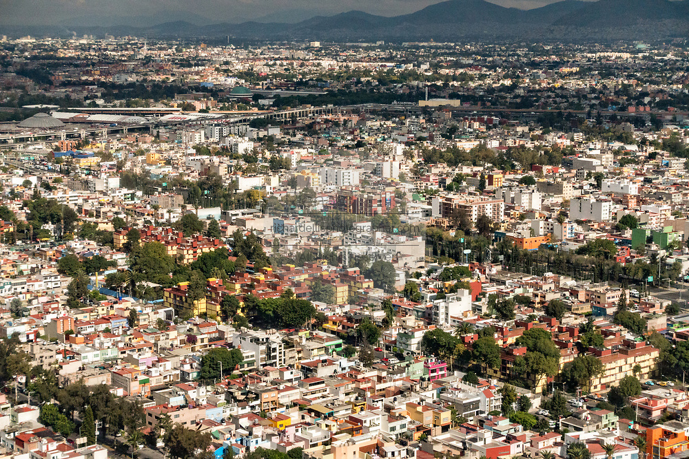 Aerial view showing the haze of pollution over the skyline of Mexico City October 25, 2017. Mexico City is the capital of Mexico and and the most populous city North America.