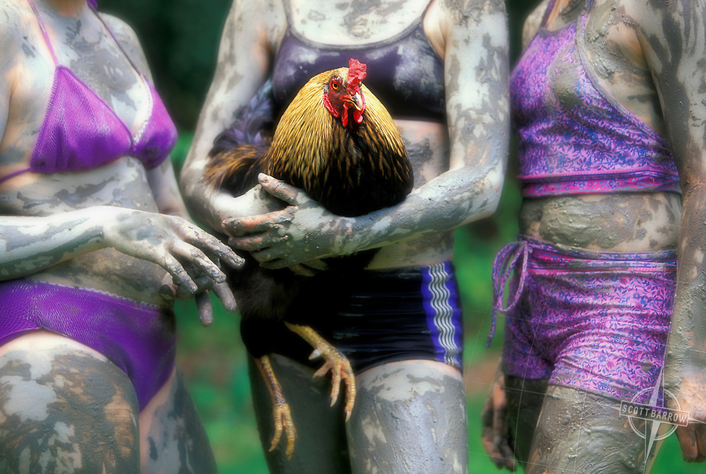 teen girls covered in mud/rooster