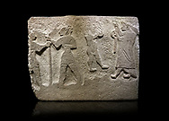 Alaca Hoyuk Hittite monumental relief sculpted orthostat stone panel. Andesite, Alaca, Corum, 1399 - 1301 B.C. Anatolian Civilizations Museum, Ankara, Turkey<br /> <br /> The rightmost figure wears a long coat and tailed dress. With both hands, he holds a sceptre with a ring in the middle. This item is thought to be a cult object in Assyria reliefs. The pointed and twisted tips of his shoes also show that he is in a high rank.  <br /> <br /> Against a black background. .<br />  <br /> If you prefer to buy from our ALAMY STOCK LIBRARY page at https://www.alamy.com/portfolio/paul-williams-funkystock/hittite-art-antiquities.html . Type - Aalca Hoyuk - in LOWER SEARCH WITHIN GALLERY box. Refine search by adding background colour, place, museum etc.<br /> <br /> Visit our HITTITE PHOTO COLLECTIONS for more photos to download or buy as wall art prints https://funkystock.photoshelter.com/gallery-collection/The-Hittites-Art-Artefacts-Antiquities-Historic-Sites-Pictures-Images-of/C0000NUBSMhSc3Oo