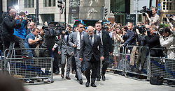 © London News Pictures. 13/07/2012. London, UK. England Footballer and Chelsea FC Captain JOHN TERRY (centre) arriving at Westminster Magistrates court on July 13, 2012, where a verdict  of not guilty was returned  today in John Terry's trial for allegedly using a racist obscenity about Queens Park Rangers player Anton Ferdinand. Photo credit: Ben Cawthra/LNP.