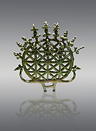 """Bronze Age Hattian ceremonial standard known as """"Sun Disks"""" from Bronze Age grave BM (2500 BC to 2250 BC), possibly a Royal grave - Alacahoyuk - Museum of Anatolian Civilisations, Ankara, Turkey. Against a gray background .<br /> <br /> If you prefer to buy from our ALAMY PHOTO LIBRARY  Collection visit : https://www.alamy.com/portfolio/paul-williams-funkystock/royal-tombs-alaca-hoyuk-bronze-age.html (TIP refine search by adding background colour in the LOWER search box)<br /> <br /> Visit our ANCIENT WORLD PHOTO COLLECTIONS for more photos to download or buy as wall art prints https://funkystock.photoshelter.com/gallery-collection/Ancient-World-Art-Antiquities-Historic-Sites-Pictures-Images-of/C00006u26yqSkDOM"""