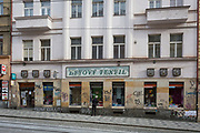 A lady looks in the window of a textiles and clothing shop on Milady Horakove street, Holesovice district, Prague 7, on 18th March, 2018, in Prague, the Czech Republic.