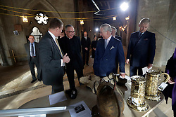 The Prince of Wales is shown artefacts by Dr Tony Trowles (centre left) the head of collections, flanked by the Dean of Westminster John Hall (centre) during his visit to the The Queen's Diamond Jubilee Galleries at Westminster Abbey in London.