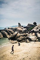 """The shoreline and the famous """"grandfather"""" rock on the eastern coast of Koh Samui in southern Thailand."""