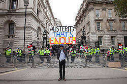 "© Licensed to London News Pictures . 20/10/2012 . London , UK . A protester on Whitehall outside Downing Street . The TUC march in London against austerity and cuts , under the banner "" March for a future that works "" . Photo credit : Joel Goodman/LNP"
