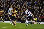 Hull city's Tom Huddlestone (8) shoots at goal but his shot is saved by West Brom keeper Ben Foster (not in pic).  Hull city's Tom Huddlestone (8) shoots just wide of goal.  Barclays Premier league, West Bromwich Albion v Hull city at the Hawthorns in West Bromwich, England on Saturday 21st Dec 2013. pic by Andrew Orchard, Andrew Orchard sports photography.