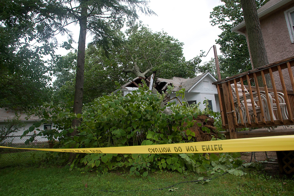 A tree falls due to a gust of wind caused by the remnants of Hurricane Irene crushing the back of a house at 134 Lexington Avenue in Pitman NJ Sunday afternoon August 28 2011. Firefighters on the scene reported no injuries caused by the falling tree.