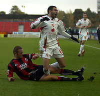 Photo: Matt Bright/Sportsbeat Images.<br /> AFC Bournemouth v Swindon Town. Coca Cola League 1. 29/12/2007.<br /> Sofiane Zaaboub of Swindon is tackled by Neil Young of Bournemouth
