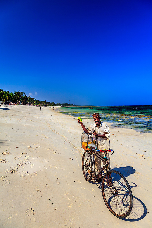 An orange seller at Tiwi beach in Kenya.