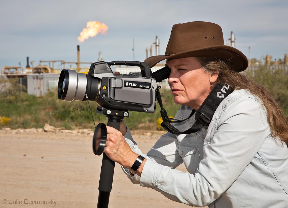 Sharon Wilson, Texas coordinator of Earthworks, with an optical gas imaging FLIR camera in the Permian Basin.