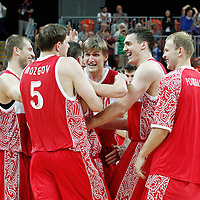 02 August 2012: Russia Vitaliy Fridzon is congratulated by his teammates at the end of 75-74 Team Russia victory over Team Brazil, during the men's basketball preliminary, at the Basketball Arena, in London, Great Britain.