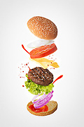 Hamburger with floating layers on light background