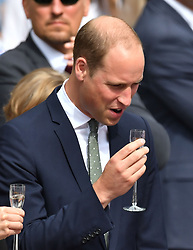 The Duke of Cambridge shares a toast during a visit to the Dlugi Targ market in Gdansk on the second day of a three-day tour of Poland.