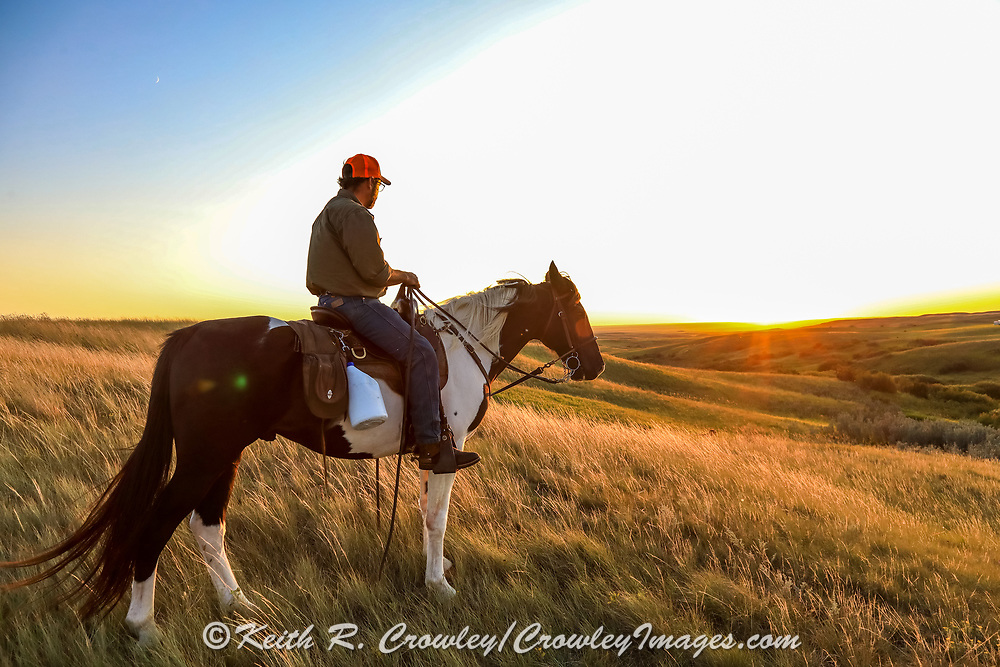 John Zeman, takes in the sunset atop his horse Buckwheat during a Montana grouse hunt.