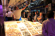 Inside mercado market fresh fish food stalls, La Latina, Madrid city centre, Spain