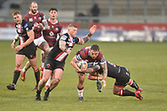 Sam Powell (9) of Wigan Warriors in action during the game