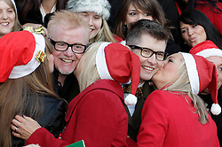 © Licensed to London News Pictures. 20/12/2011. London, United Kingdom .Gareth Malone and Chris Evans get kisses from members of the Military Wives Choir outside of HMV on Oxford Street to celebrate the success of the Military Wives single..Photo credit : Chris Winter/LNP