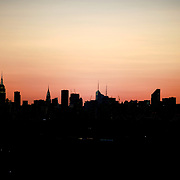 2017 U.S. Open Tennis Tournament - DAY ELEVEN. The Manhattan skyline at sunset shot from the Arthur Ashe Tennis Stadium, Queens New York, during the US Open Tennis Tournament at the USTA Billie Jean King National Tennis Center on September 07, 2017 in Flushing, Queens, New York City.  (Photo by Tim Clayton/Corbis via Getty Images)