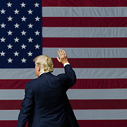 President Donald Trump waves to the crowd as he makes his exit at the end of a rally, Monday, Aug. 21, 2018, at the Charleston Civic Center in Charleston, W.Va.