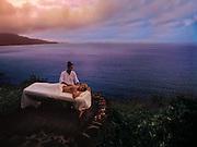 A vacationer enjoys a massage on the coast