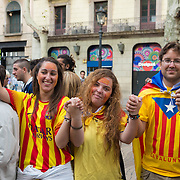 Catalan young people with the pattern of the independence flag on the National Day of Catalonia, Barcelona, Spain