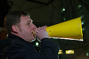 Tom Schmid, National Chair of Democrats Abroad Japan, talks to the crowd before a protest march by members of the Democratic Party Abroad organisation to mark the inauguration of President Donald Trump, Tokyo, Japan. Friday January 20th 2017 Around 400 people took apart in the march, which started in Hibiya Park at 6:30pm and finished in Roppongi just before 8pm, to honour the service given by President Obama and to protest against the illiberal policies expected of the new administration of President  Trump.