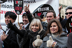 "© Licensed to London News Pictures. 23/11/2015. LONDON, UK. Former Doctor Who girls, Katy Manning and Sophie Aldred  (centre), stand with fans of Doctor Who known as ""Whovians"" and other supporters of the BBC gathered outside Broadcasting House in central London to oppose the threat of 20% government cuts to the Corporation which has brought shows such as Dr Who since 1922. Photo credit : Stephen Chung/LNP"