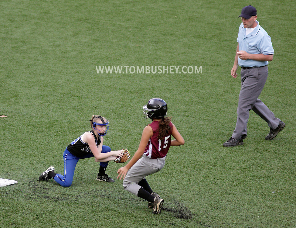 Chester, New York - A fielder gets ready to tag a runner during a girls softball tournament at the Rock Sports Park on May 21, 2011.
