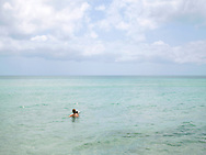 woman and dog in Caribbean Sea