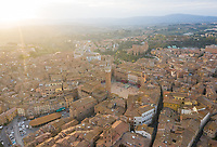 Aerial view above of historic city of Siena during sunset, Italy.