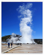 The Excelsior Geyser Crater steaming up into a deep blue sky at the The Midway Geyser Basin, Yellowstone National Park, Wyoming, USA