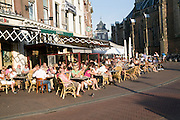 People sitting outside cafe, Haarlem, Holland