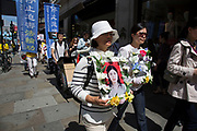 Members of Falun Gong or Falun Dafa protest concerning the alleged improsonment / torture and organ harvesting of fellow members in mainland China on 16th July 2016 in London, United Kingdom. They claim that tens of thousands of fellow practitioners are being held unlawfully in Chinese prisons.