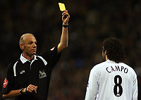 Photo: Paul Thomas.<br /> Bolton Wanderers v Chelsea. The Barclays Premiership. 29/11/2006.<br /> <br /> Referee Steve Bennett (L) gives Ivan Campo of Bolton a yellow card.