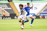 LEICESTER, ENGLAND - JULY 04: Jairo Riedewald of Crystal Palace shields the ball from Ayoze Perez of Leicester City during the Premier League match between Leicester City and Crystal Palace at The King Power Stadium on July 4, 2020 in Leicester, United Kingdom. Football Stadiums around Europe remain empty due to the Coronavirus Pandemic as Government social distancing laws prohibit fans inside venues resulting in all fixtures being played behind closed doors. (Photo by MB Media)