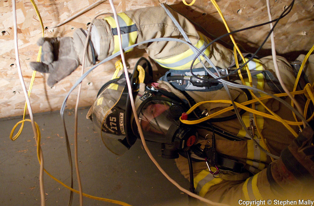 Iowa City Firefighter Branden Sobaski shows students how to navigate through wires in the SCBA Confidence Course during a job shadow with the Iowa City Fire Department at the Iowa City Fire Department Training Center, 1001 South Clinton Street, in Iowa City on Thursday afternoon, November 18, 2010. The job shadow was organized by Workplace Learning Connection.