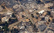 A section of the town of Yarnell, Arizona is destroyed by a wildfire that ripped through the town June 30, 2013, seen from the air July 1, 2013.  An elite squad of 19 Arizona firemen was  killed in the worst U.S. wildland firefighting tragedy in 80 years apparently outflanked and engulfed by wind-whipped flames in seconds, before some could scramble into cocoon-like personal shelters. REUTERS/Rick Wilking (UNITED STATES)
