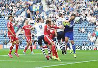 Preston North End's Paul Huntington puts pressure on Middlesbrough's Dimitrios Konstantopoulos<br /> <br /> Photographer Dave Howarth/CameraSport<br /> <br /> Football - The Football League Sky Bet Championship - Preston North End v Middlesbrough -  Sunday 9th August 2015 - Deepdale - Preston<br /> <br /> © CameraSport - 43 Linden Ave. Countesthorpe. Leicester. England. LE8 5PG - Tel: +44 (0) 116 277 4147 - admin@camerasport.com - www.camerasport.com