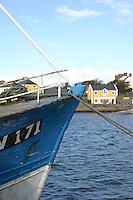 Boat moored at Kilronan Harbour Inis Mor Aran Islands County Galway