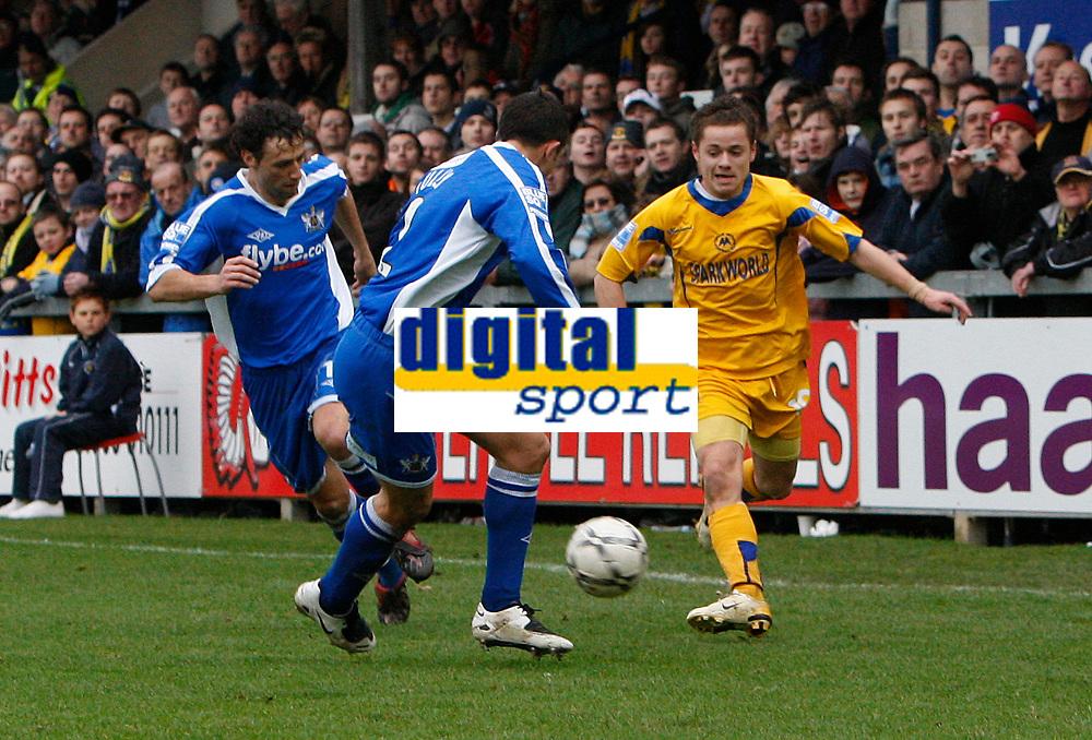 Photo: Steve Bond/Sportsbeat Images.<br />Torquay United v Exeter City. The FA Blue Square Premier. 01/01/2008. Danny Stevens, (R) takes on Steve Tully (C)