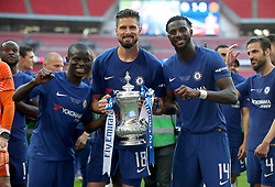 Chelsea's N'Golo Kante (left), Olivier Giroud (centre) and Tiemoue Bakayoko celebrate with the FA Cup trophy