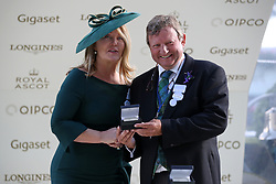 Kirsty Young presents the winning trainer trophy to Mark Johnston after the King George V Stakes during day three of Royal Ascot at Ascot Racecourse.