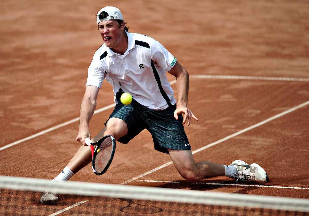 Ilia Marcenko of Ucraine  returns a ball to Roamania's Victor Hanescu, during their match in the Davis Cup, in Bucharest.