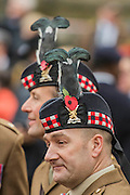 A Scottish regiment wears feathers in their hats - The Duke of Edinburgh, Life Member, Royal British Legion, accompanied by Prince Harry, visit the Field of Remembrance at Westminster Abbey  - 10 November 2016, London.