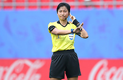 Referee Qin Liang in conversation with VAR after England's second goal during the FIFA Women's World Cup, round of Sixteen match at State du Hainaut, Valenciennes.