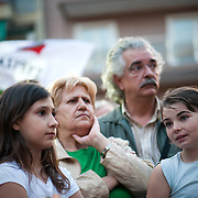 People cheering Alexis Tsipras just after  his speech in the open Assembly of SYRIZA in Aghia Ekaterini Square, in the Kato Petralona neighbourhood  of Athens.