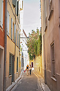 Street in the old town. Two girls. Perpignan, Roussillon, France.