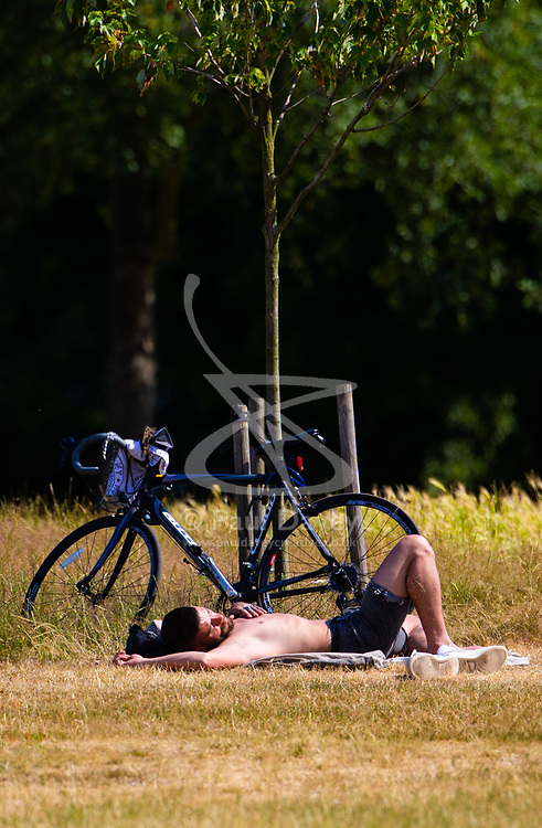 A man relaxes in the hot morning sunshine in Hyde Park as another heatwave day begins with temperatures expected to soar. London, July 01 2018.