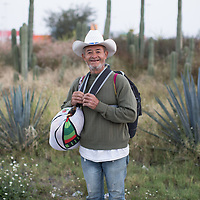 I've met this man from Ocotepeque, Honduras since the border at Tapachula. Here he walks on the road to Irapauto, Guanajuato.