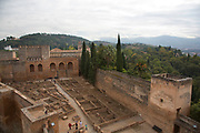 The Alhambra Palace and fortress complex located in Granada, Andalucia, Spain. The tallest section and military watchtower, The Alcazaba. Here looking down at the Plaza de Armas.